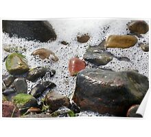 Colorful stones washed by the foaming water on the beach Poster