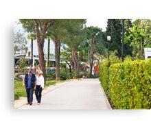 a couple walking alone the side of lake garda Canvas Print
