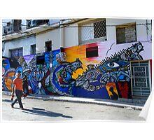 2 men passing mural, Havana, Cuba Poster