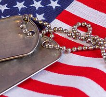 Military dog tags on American Flag by nscphotography