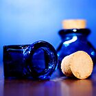 Blue glass bottles by Lissywitch