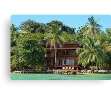 Tropical waterfront beach house Canvas Print