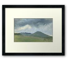 Storm clouds over the hill Framed Print