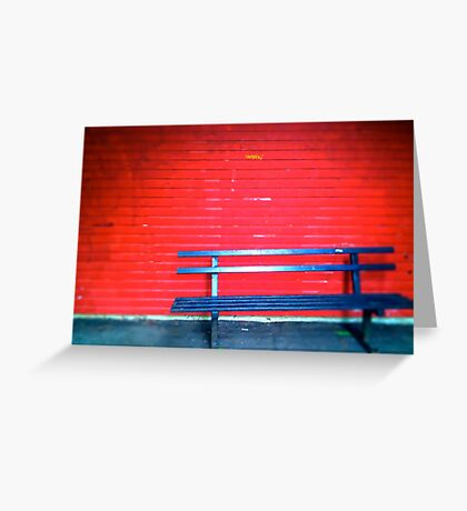 Bench with red background Greeting Card