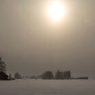 Snowy Finland, field and houses with misty sun by Katariina Jarvinen