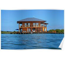 Wooden tropical home over water of Caribbean sea Poster