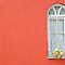 White window on red wall by Alexandru Vita