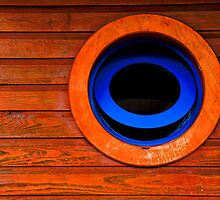 Round blue window - St Martin, DWI by Susana Weber