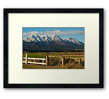 Capped in snow Framed Print