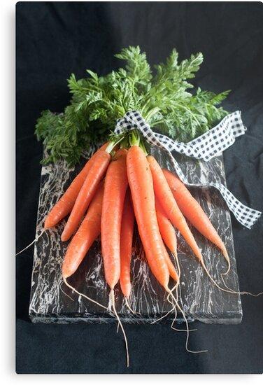 Carrots on Black by Ilva Beretta