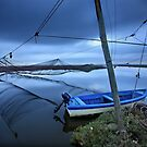 Lonely boat at the Delta of Aliakmonas river by Hercules Milas
