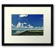 Earth, water, and sky Framed Print