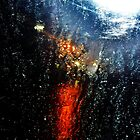 Let there be light  ( Street lamp shining through rain on a car window) by Redviolin