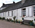 Row of Cottages in Scotland by Carol Bleasdale
