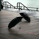 2 umbrellas on pier by orion plexus