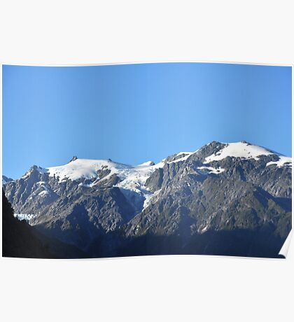 Snow capped mountains in Franz Josef New Zealand Poster
