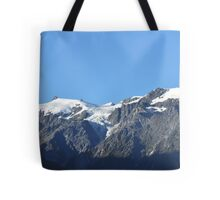 Snow capped mountains in Franz Josef New Zealand Tote Bag