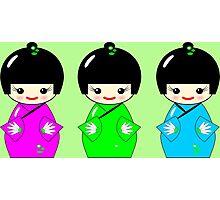 Cute Kokeshi dolls on green Photographic Print