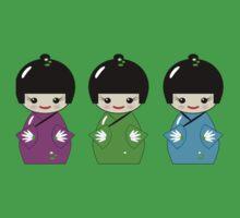 Cute Kokeshi dolls on green Kids Tee