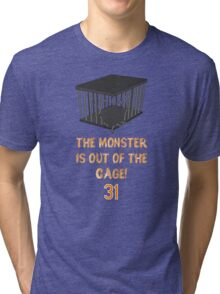 The monster is out of the cage. Tri-blend T-Shirt