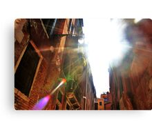 light flare through the buildings Canvas Print