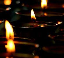 flame. mcleod ganj, northern india by tim buckley | bodhiimages