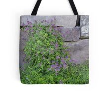 Flowers by Wall Tote Bag