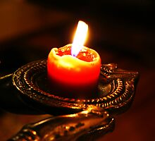 Burning red candle with bright flame by jegi52001