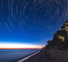 Chasing the stars on the shore of Lake Michigan by Andy Donaldson