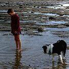 Joy is a boy, a dog and a rock pool.........! by Roy  Massicks