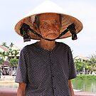 Lady on the Hoi An Bridge by mooksool