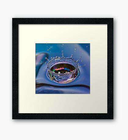 Splash of water coming down Framed Print