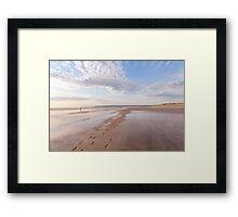 Footprints and reflections at Westward Ho! beach in North Devon, UK Framed Print