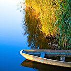 Lone boat by Valerii Baryspolets