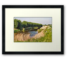 A fisherman in the polder Framed Print
