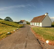 Thatched cottages by John Quinn