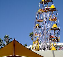 Yellow Ferris Wheel Against Blue Sky by kaevhe