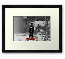 Grey-scale blue boy in white snow.  Framed Print