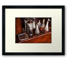 Barber - On the counter Framed Print