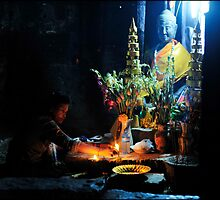 Buddhist worshipper Bayon Temple by Tim  Barnsley