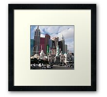 statue of liberty in city Framed Print