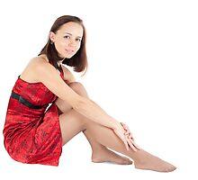 resting beautiful girl sitting on the floor by sergeylukianov