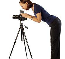 beautiful female photographer with big camera by sergeylukianov