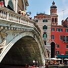 Canal under a Bridge in Venice, Italy by Laura Cooper