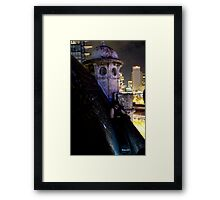 A caped crusader watches over gotham Framed Print