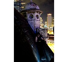 A caped crusader watches over gotham Photographic Print