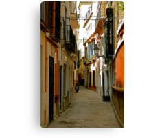 A narrow street and a motorbike Canvas Print