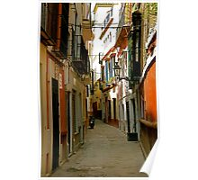 A narrow street and a motorbike Poster