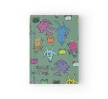 pattern with goats and frogs Hardcover Journal