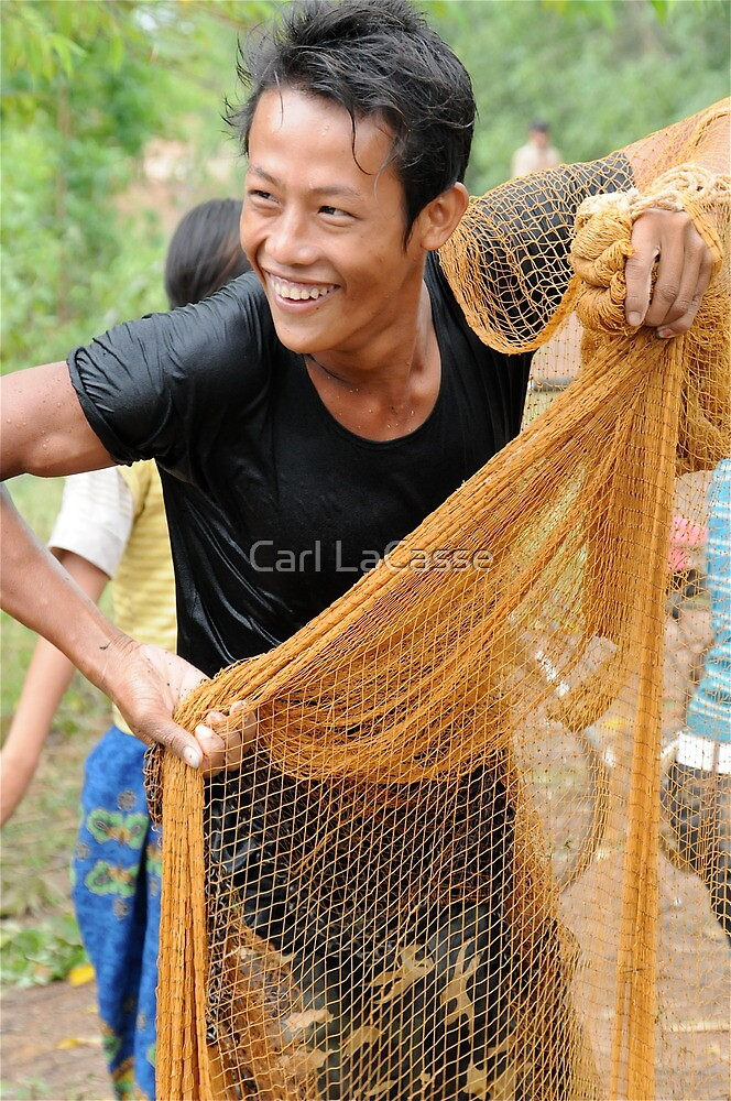 Teaching how to fish with a throw net by Carl LaCasse